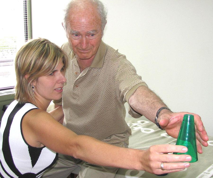 Neuro-Rehabilitation services: man grabbing cone
