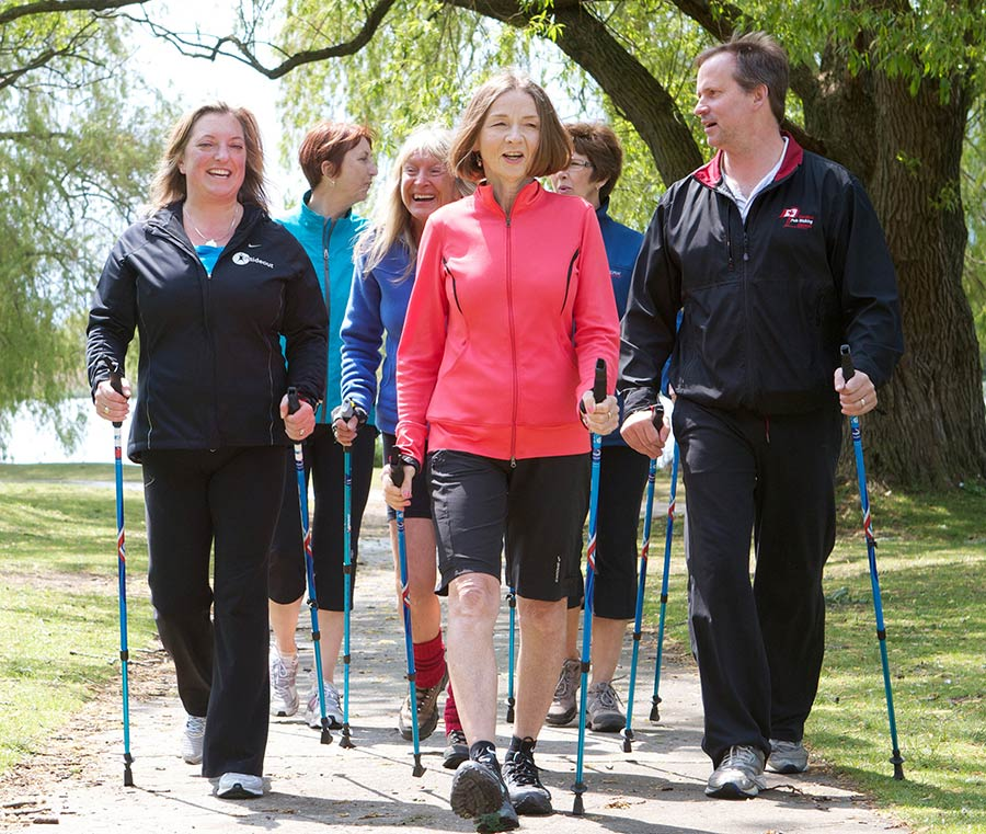 Nordic Pole Walking for Groups group in forest
