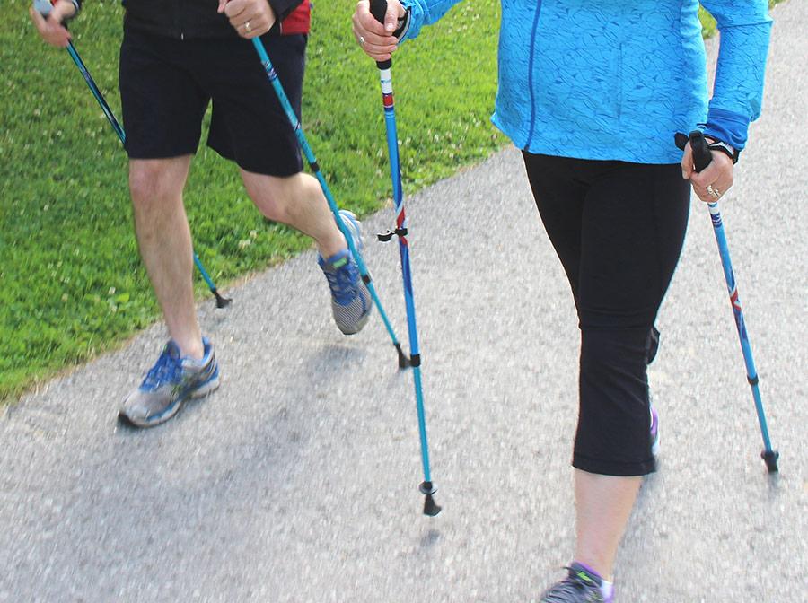 Nordic pole walking waist down shot 2 people