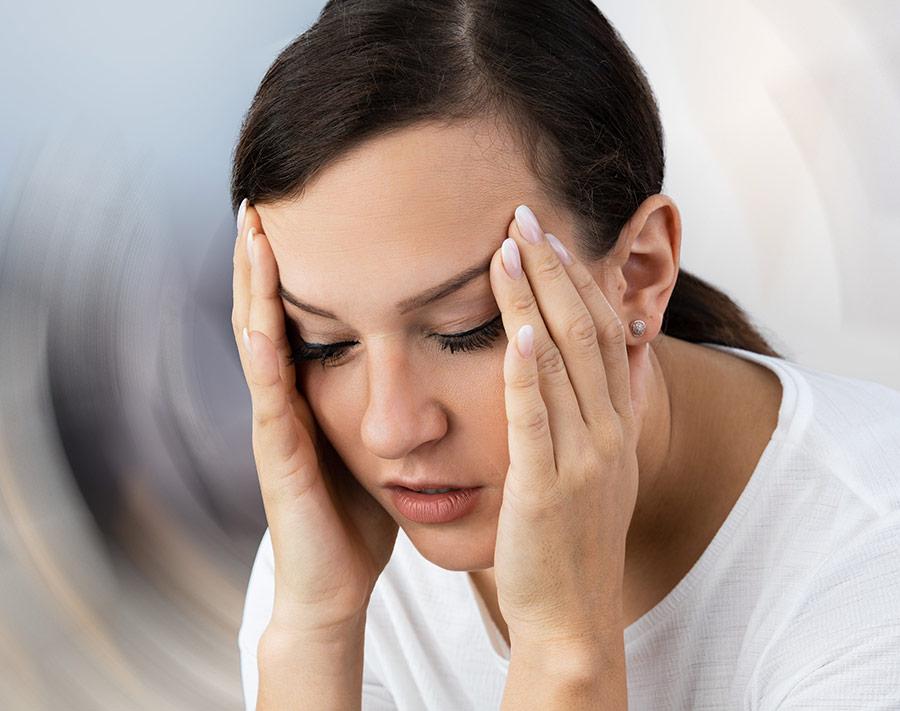 Vestibular Therapy holding spinning head