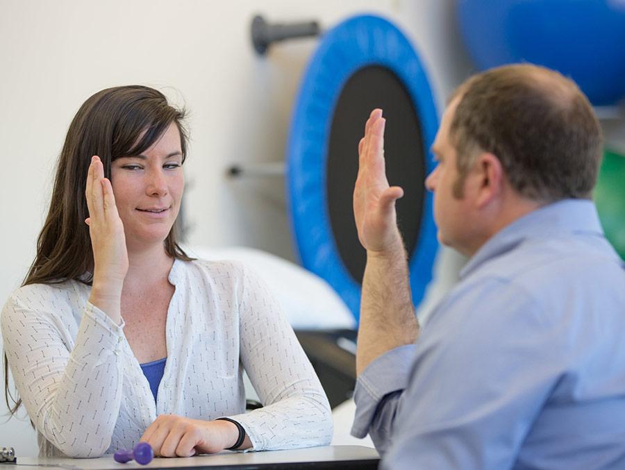 Vestibular Therapy holding up hands